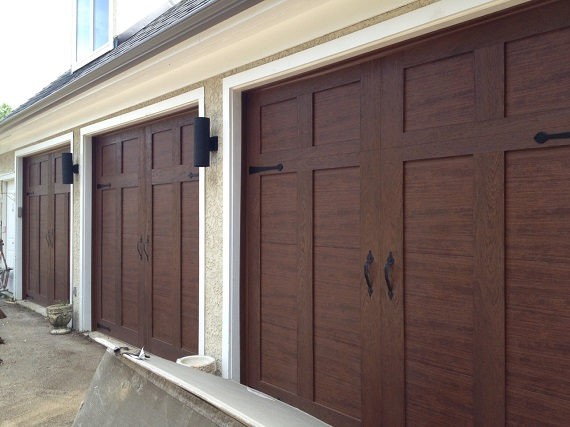 Doors done right garage doors and openers comparing for Clopay canyon ridge ultra grain price