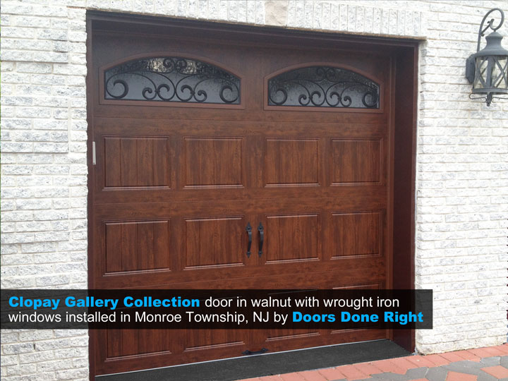 clopay-gallery-collection-garage-door-with-walnut-finish-and-wrought-iron-windows