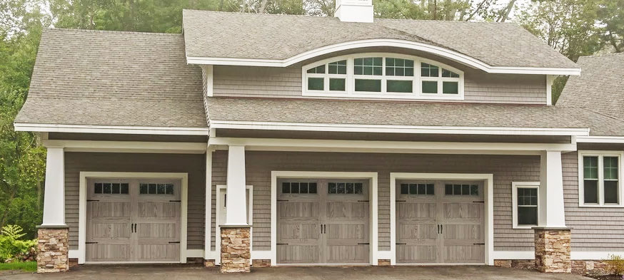 chi model 5983 stamped steel carriage house garage door in accents driftwood