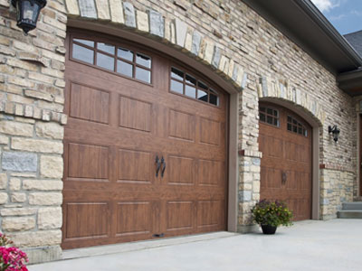 clopay gallery collection stamped steel carriage house garage door medium finish gd2lp