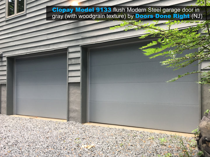 clopay model 9133 flush modern steel garage door in gray with woodgrain texture