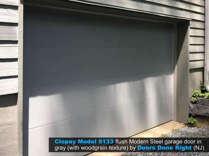 clopay model 9133 flush modern steel garage door in gray without windows
