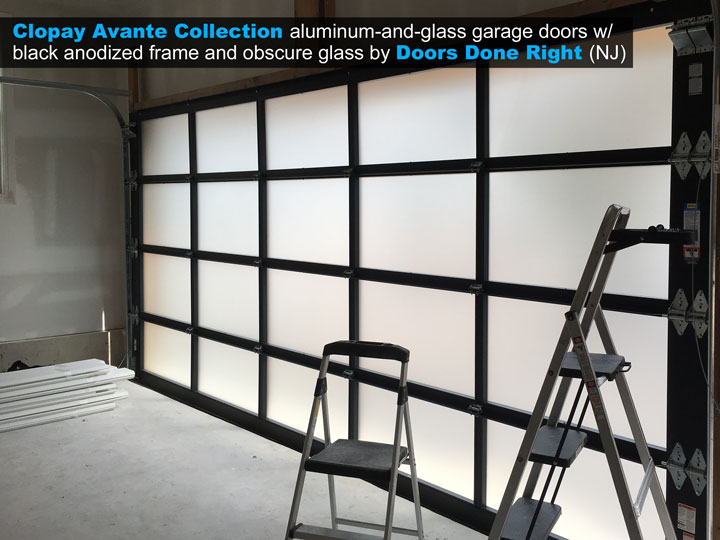 16 ft x 8 ft Clopay Avante aluminum and glass garage door with black anodized frame and obscure glass