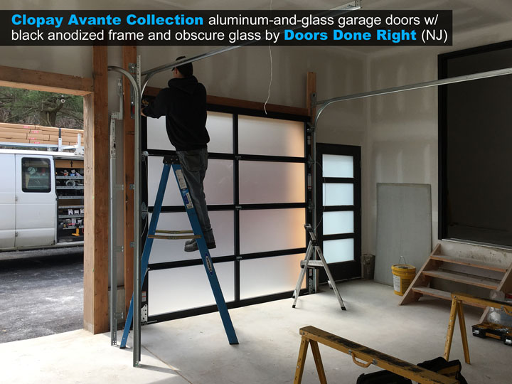 8 ft x 8 ft Clopay Avante aluminum and glass garage door with black anodized frame and obscure glass