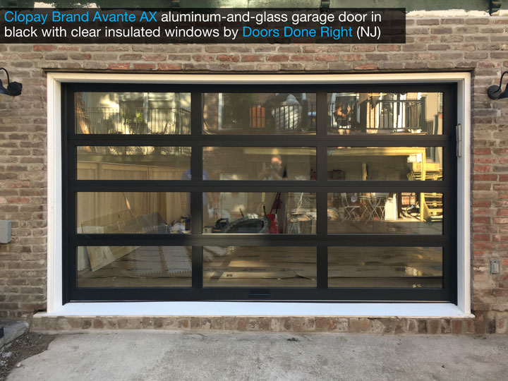 Clopay Avante AX aluminum-and-glass modern garage door in black with clear insulated glass - front view