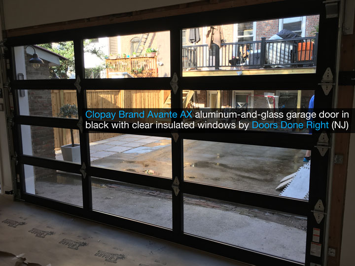 Clopay Avante AX aluminum-and-glass modern garage door in black with clear insulated glass - inside view