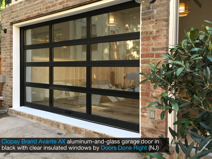 Clopay Avante AX aluminum-and-glass modern garage door in black with clear insulated glass - side view