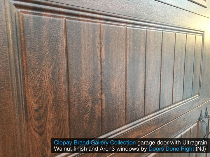 clopay gallery collection garage door with walnut ultragrain finish - closeup