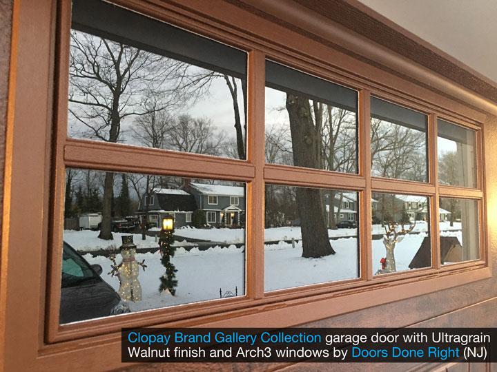 clopay gallery collection garage door with walnut ultragrain finish - window closeup