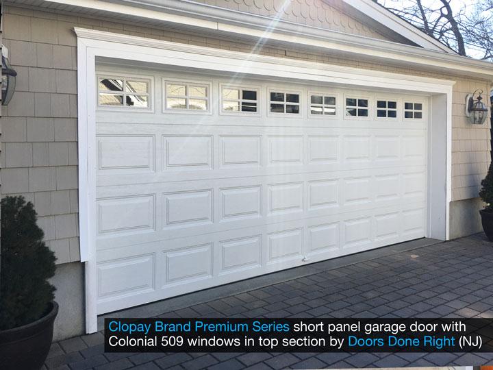 Clopay Premium Series model 9200 steel raised panel garage door - short panel with Colonial 509 windows angle view
