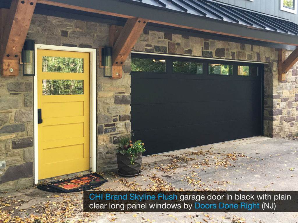 chi model 2284 skyline flush garage door in black with clear long panel windows in top door section - angled view