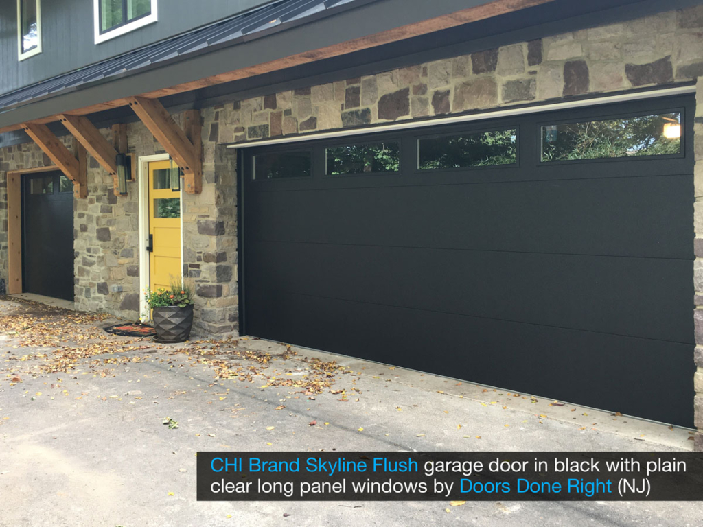 chi model 2284 skyline flush garage door in black with clear long panel windows in top door section - other view