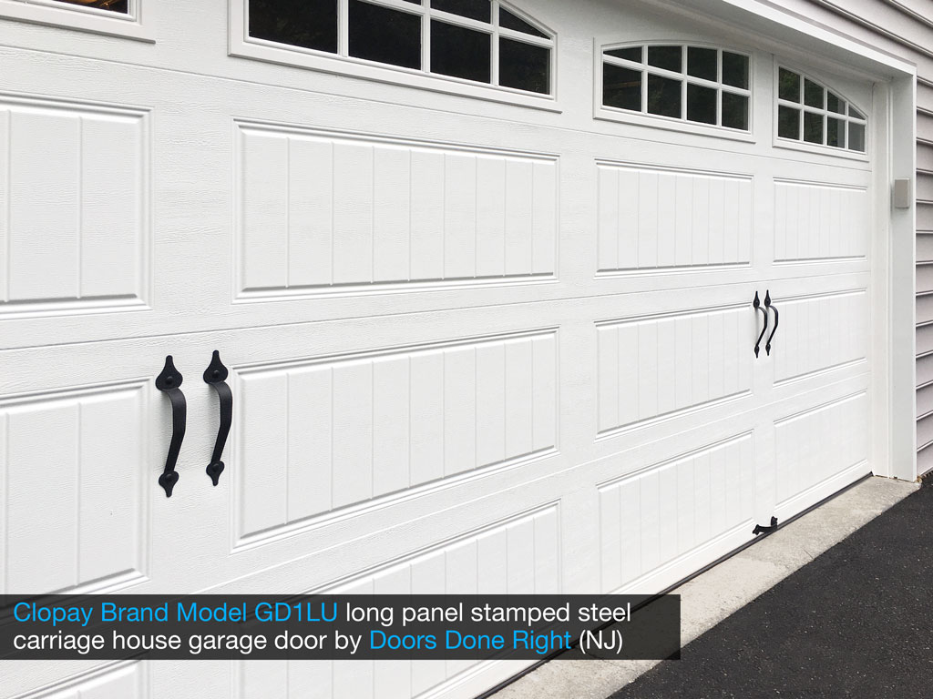 clopay brand stamped steel carriage house garage door model gd1lu with arch1 with grilles windows - panel closeup