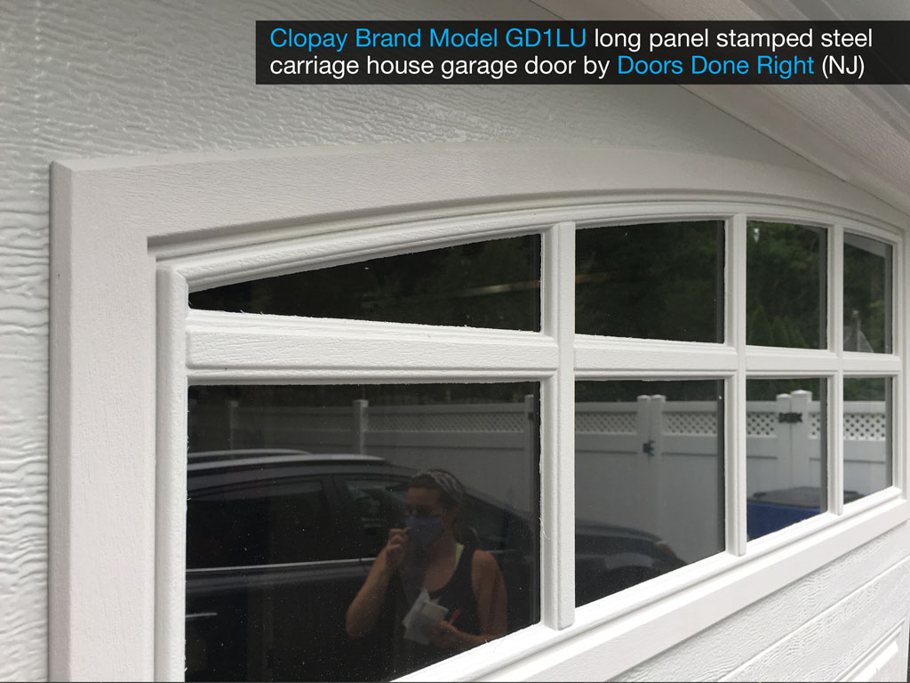 clopay brand stamped steel carriage house garage door model gd1lu with arch1 with grilles windows - window closeup